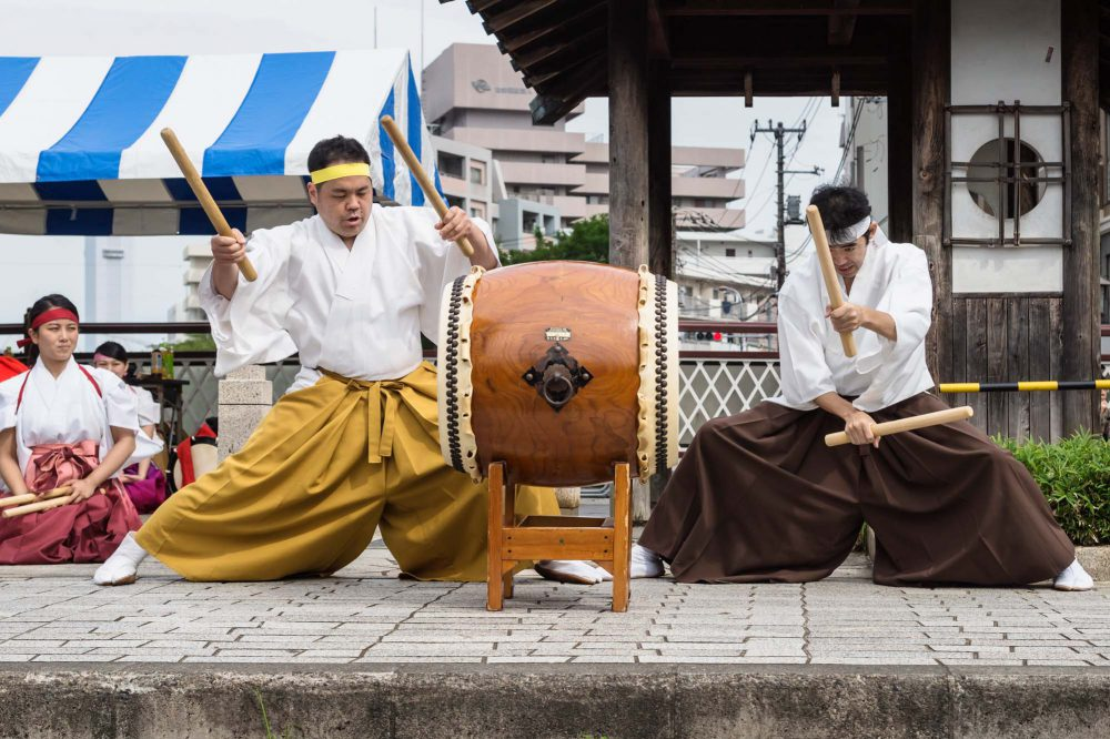 Tokyo Japan Drummers with drum and sticks in traditional clothing at Shinagawa Shukuba Matsuri festival