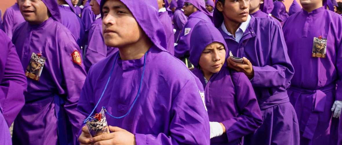 Antigua Guatemala young purple robed men cueing in semana santa procession of San Bartolome de Becerra