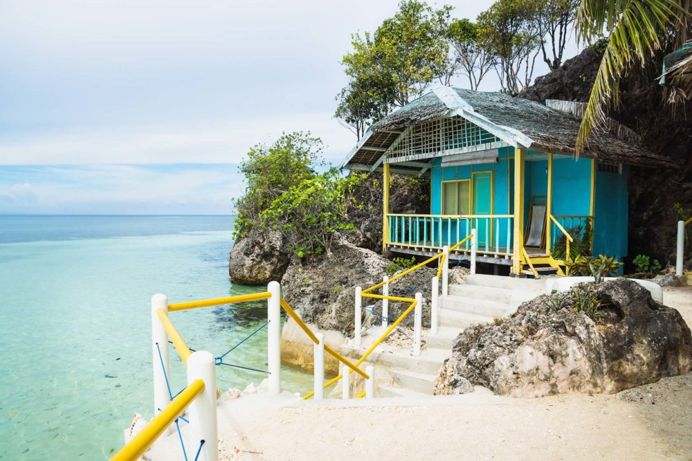 Small turquoise Bungalow at the turquoise ocean of Siquijor, Philippines, Asia